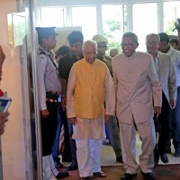 Dr. Prasanta Banerji accompanies HE inside the hall